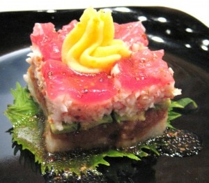 Sushi cake; cake formation with layers of crab, spicy tuna, tuna, rice, mashed potato with caviar
