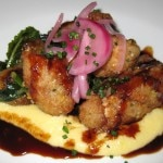 Crispy veal sweetbreads with corn grits and cipollini onions