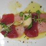 Hamachi crudo with truffle ponzu, charred green onion aioli and beignet de chanterelles