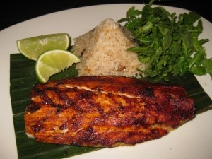 Pescado Zarandeado: wood-grilled striped bass basted with red chili, served with Veracruz-style white rice with sweet plantains and arugula salad