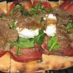 Italian Umbria shaved black summer truffle tart with Coppa ham, buratta and Arbequina olive oil