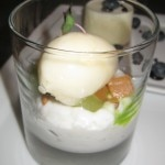 Coconut rice pudding with summer melon sorbet and candied pine nuts