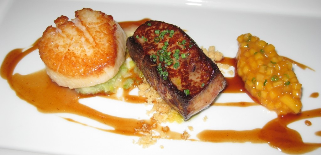 Diver scallops and foie gras with poached peaches, red wine reduction and almond streusel