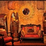 A sunburst and sarcophagus adorn Muriel's Séance Lounge
