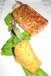 Tasmanian ocean trout baked in sea salt with cippolini, peas, mint and crispy polenta