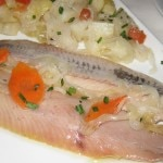 Herrings marinated with warm boiled potatoes and onions