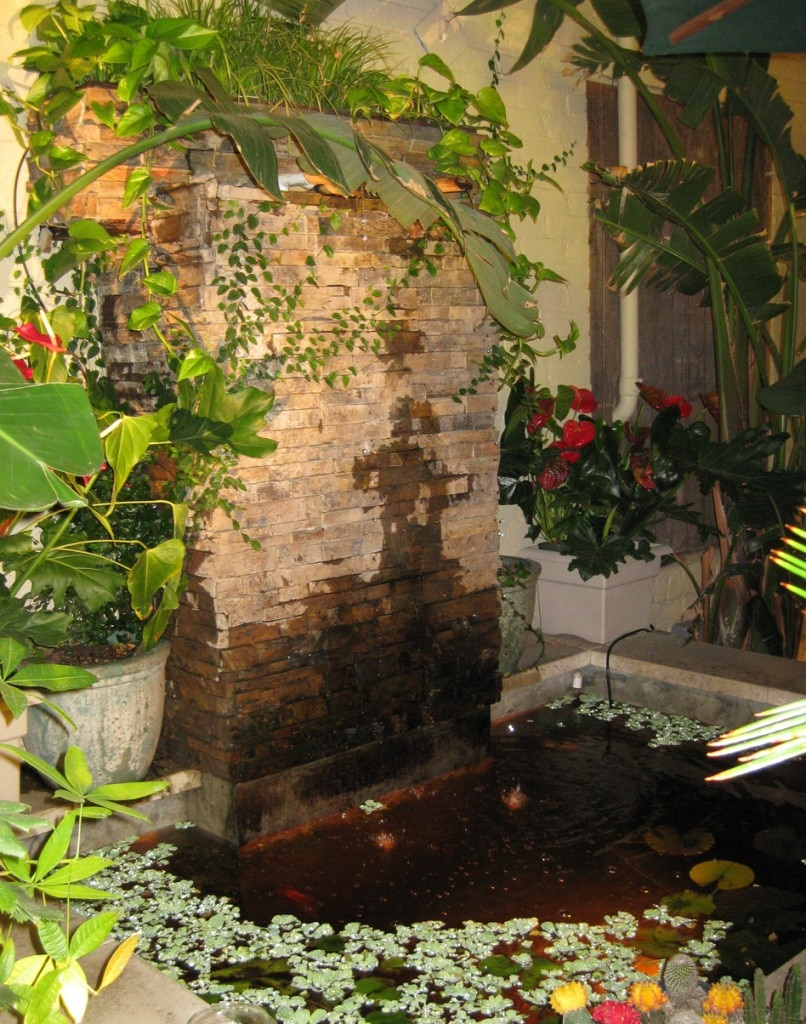 The smokers corner greets guests with lush vegetation