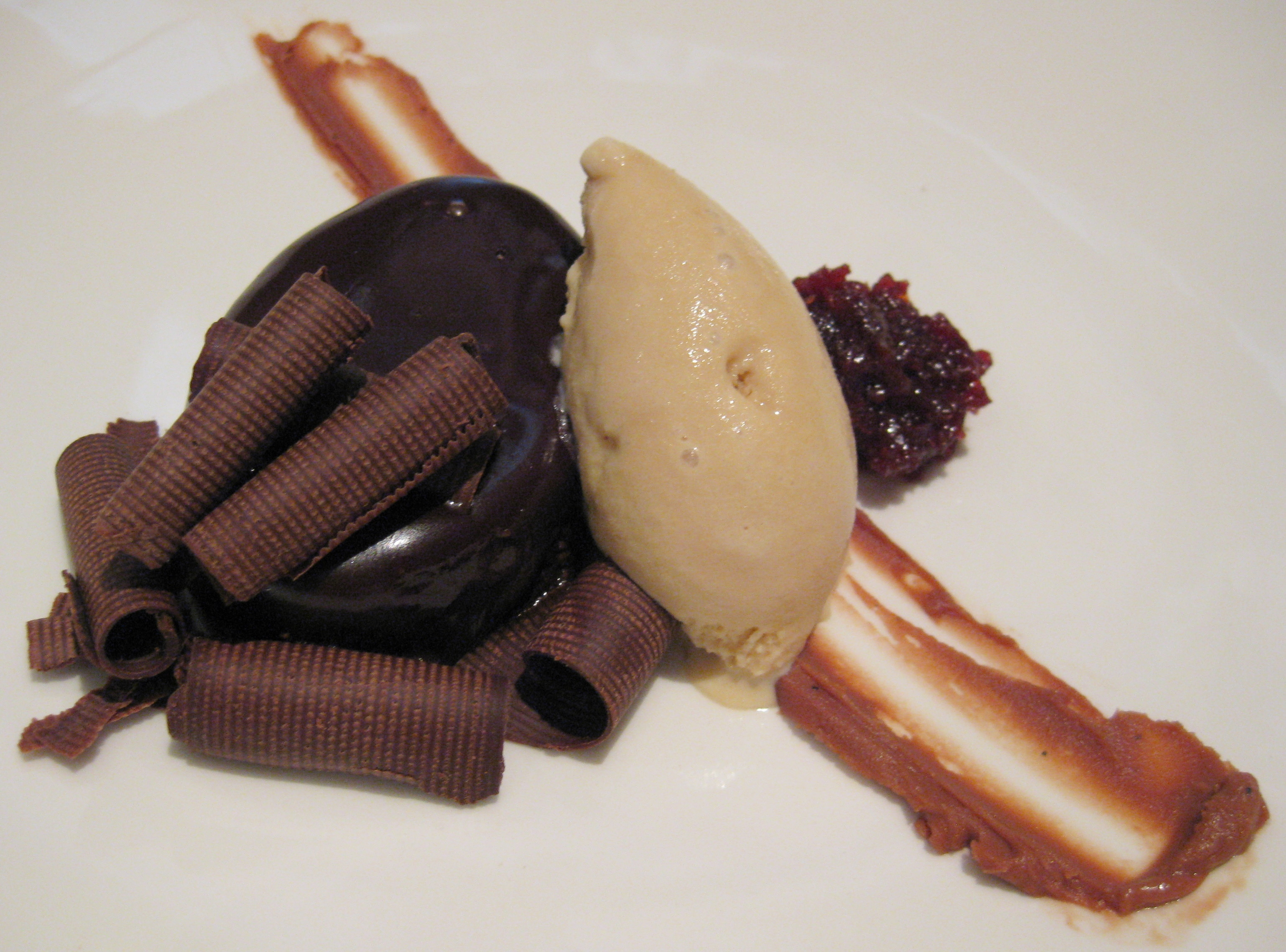 Dark chocolate torte with spiced cherries and roasted white ...