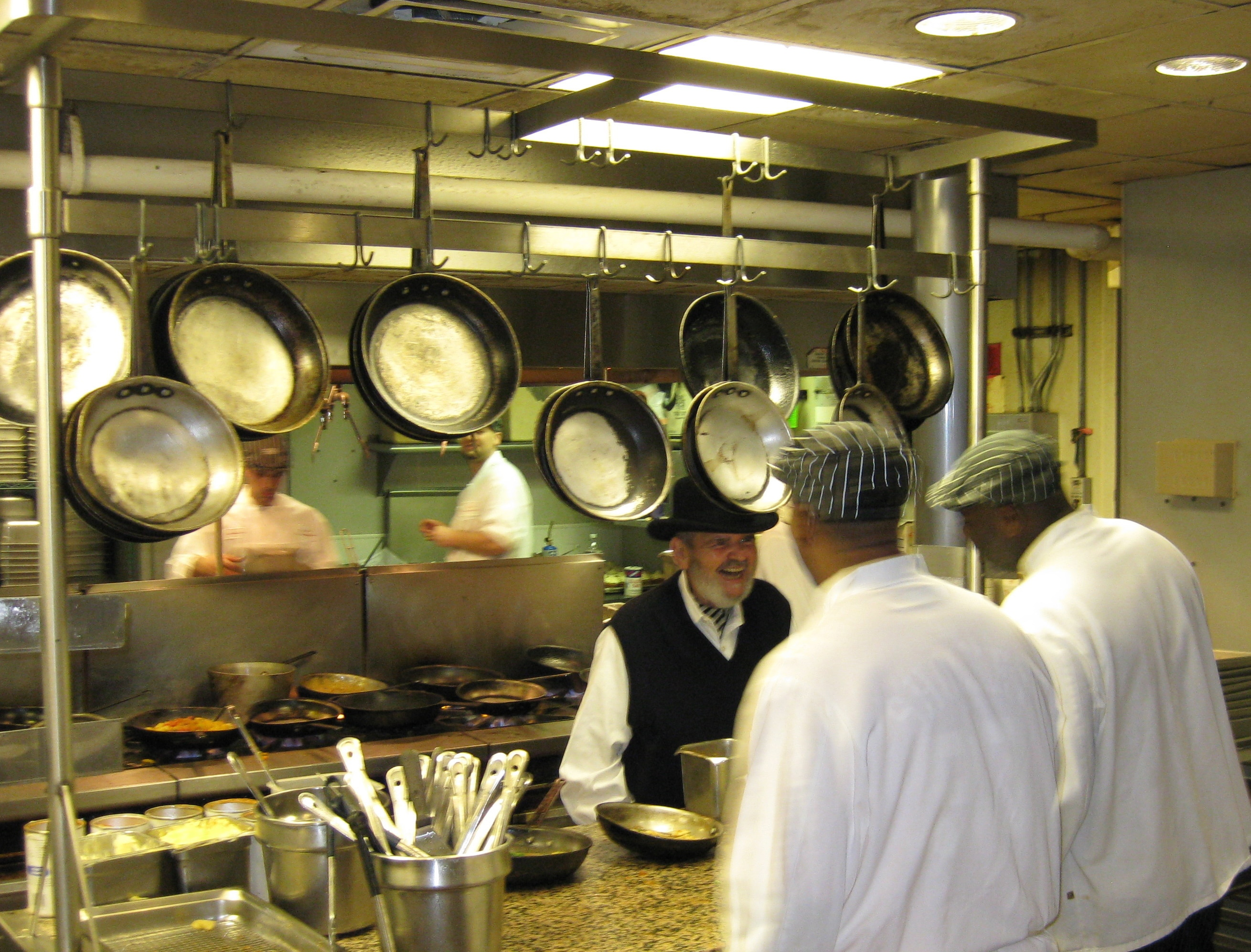 chef paul prudhomme and crew hard at work behind the scenes at k