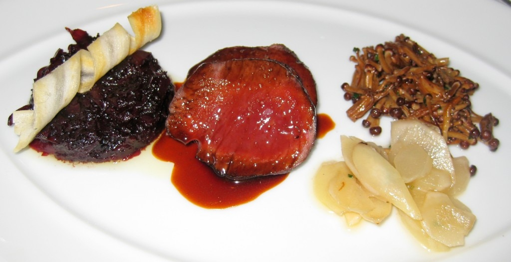 Sautéed venison with salsify, golden enoki mushrooms, braised red cabbage and grande veneur sauce