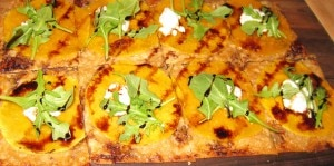 Butternut squash tart with caramelized onions, goat cheese, arugula and balsamic reduction