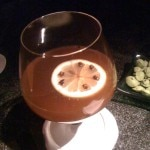 The Wassail: hot cider spiked with rum and garnished with a clove-studded lemon twist