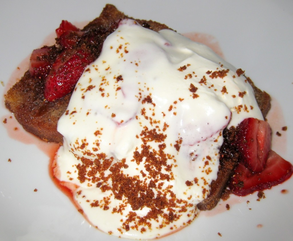 Spiced pound cake with sautéed strawberries, whipped crème fraiche and gingersnap crumble