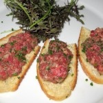Steak tartare with capers, anchovies, shallots, parsley, egg yolk, Dijon, Tabasco sauce, Cognac, Worcestershire sauce