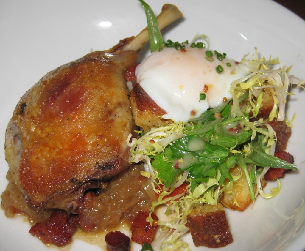 Duck confit with peas and carrots