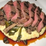 Grilled ribeye, Gorgonzola polenta, wild mushrooms, braised collards