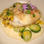 Pan seared cod, roasted corn, cauliflower purée, shaved artichokes