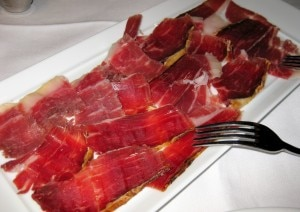 pata negra ham 300x212 Platter of pata negra cured ham, bellota bellota variety, with tomato on a slice of bread
