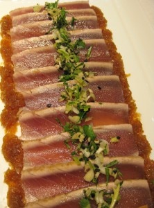 Thinly-sliced fresh seared tuna with soy and ginger vinaigrette dressing