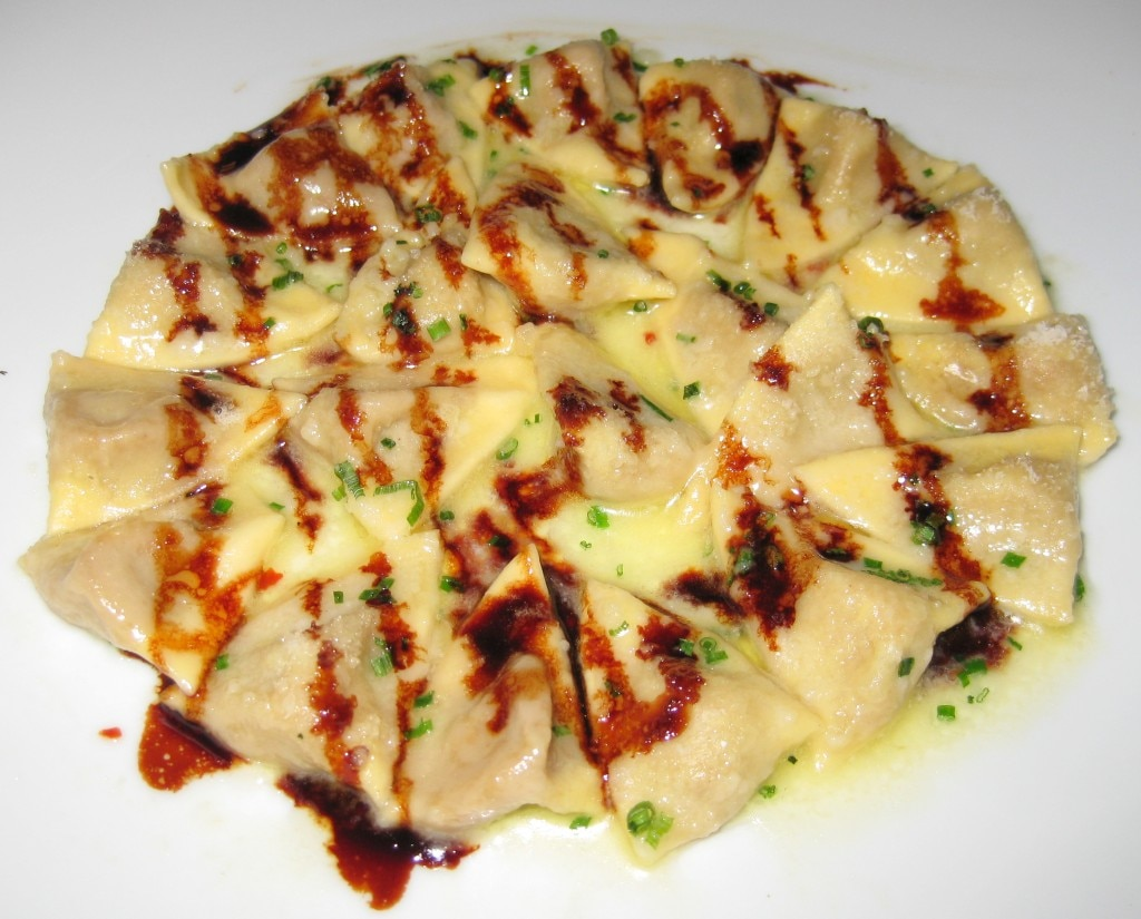 Duck and foie gras ravioli in a Marsala reduction