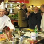 Jean-Francois Daigle, preparing his dish. In the background, James Beard Vice President Mitchell Davis, chefs Michel Richard and Bob Hurley