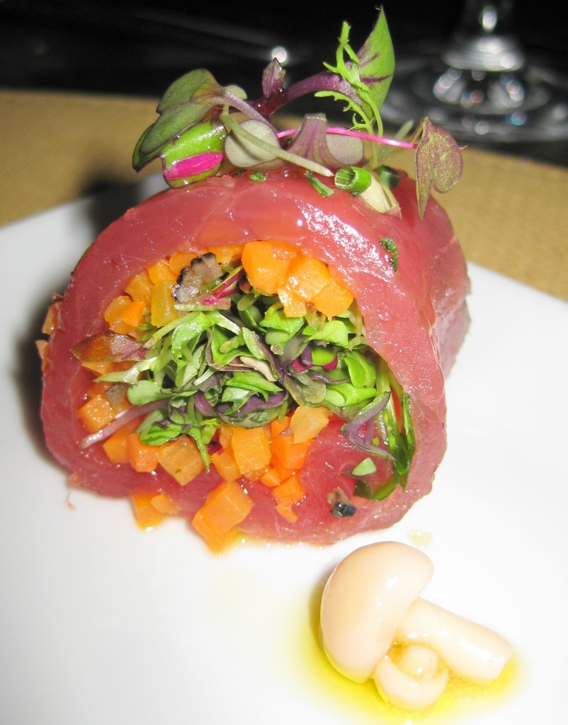 Raw tuna rolled and stuffed with marinated vegetables and preserved truffles