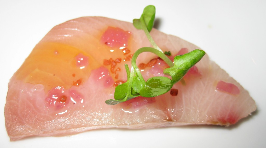 Raw yellowtail with zenzero oil and pickled red onion