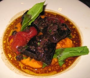 Braised beef daube with carrot purée, tomato confit and tapenade