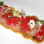 Hiramasa crudo with compressed watermelon, fried garlic, ponzu and cilantro flowers