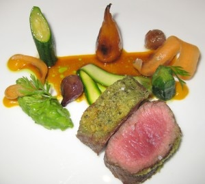 Caper-crusted lamb loin with Weiser carrots, fava beans, pearl onions and mint-infused lamb jus