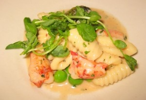 Lobster pasta with English peas, lobster cream and pancetta