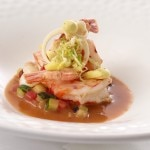 Ruby red shrimp with curry meringue, hearts of palm and lime in a coconut jus