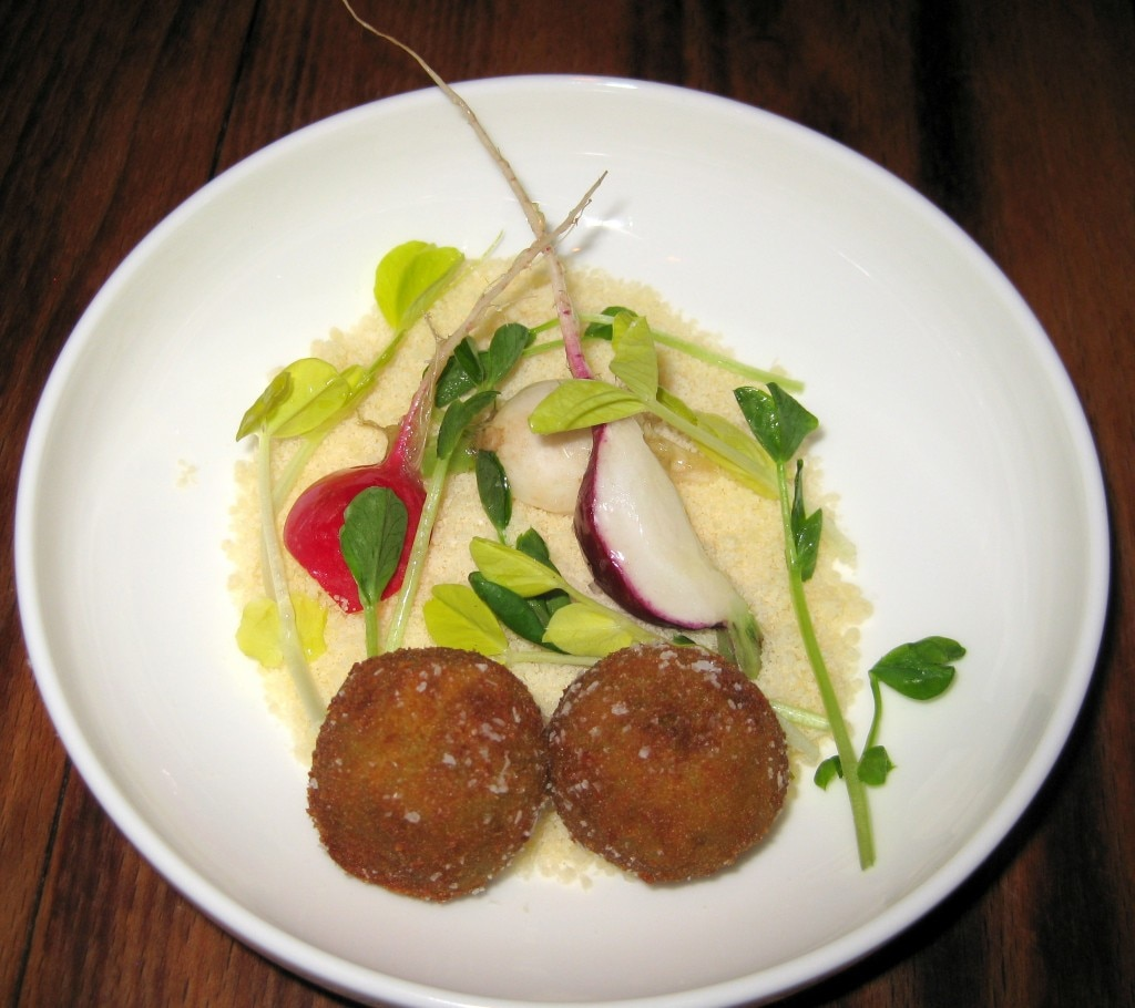 Sweet petit pois arancini on a bed of pea shoots and Coleman farm radishes