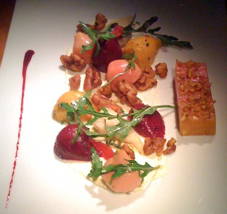 Heirloom beet salad with persimmon, candied walnuts and goat cheese
