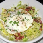 Frisée aux lardons: frisée, lardons, fried egg and sherry vinaigrette