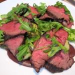 Grilled beef hangar steak with fingerling potatoes, king trumpet mushrooms, asparagus, black olives and arugula