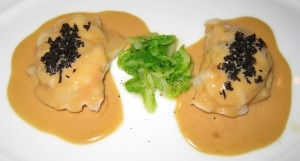 Langoustine ravioli with green cabbage, truffles, foie gras sauce