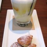 Orange creamsicle float with orange sorbet, cream soda and cardamom madeleine