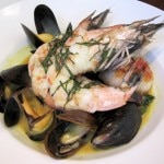 Prawn and shellfish curry with mussels, scallops, spinach, lemongrass and Thai basil