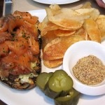 Loch Duart salmon pastrami with grilled country bread, lemon slaw, dill pickles, grain mustard and potato chips