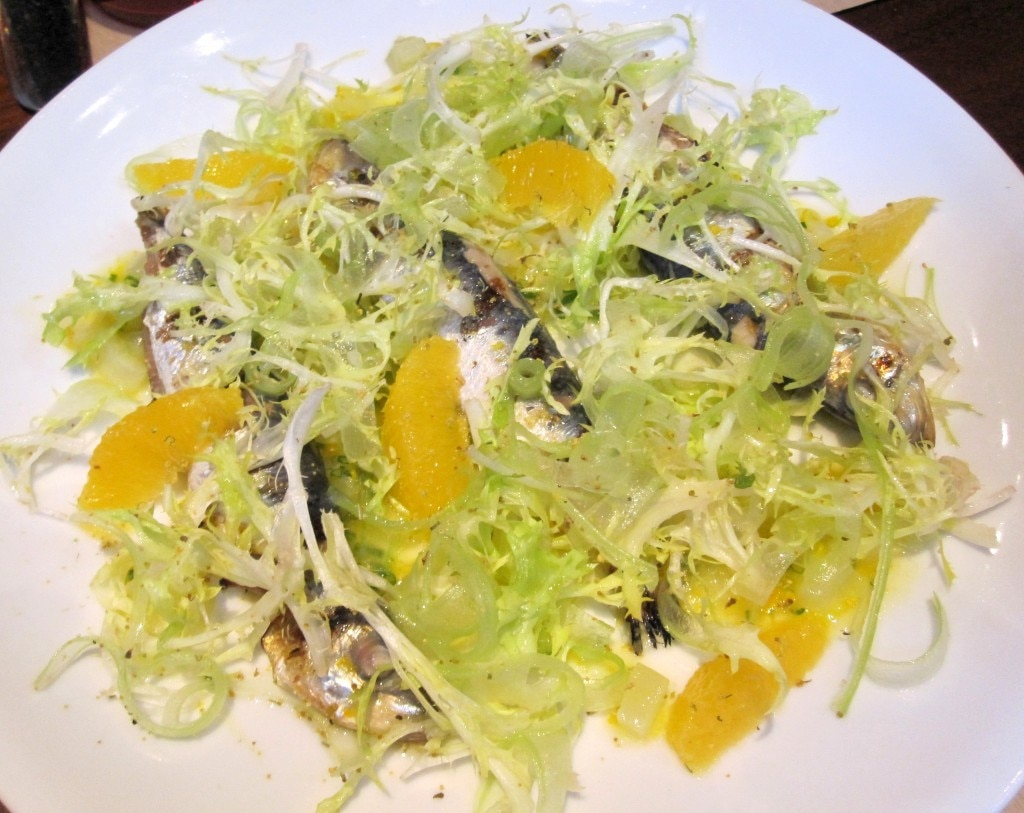 Grilled and marinated Monterey Bay sardines with navel orange, fennel, celery and frisée