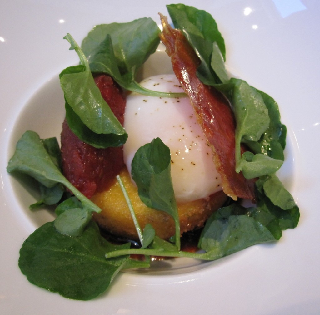 Soft-poached egg with crispy semolina dumpling, tomato compote, watercress and Serrano ham