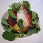 Soft-poached egg with crispy semolina dumpling, tomato compote, watercress and Serrano ham