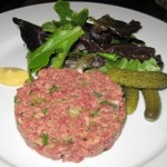 Steak tartare: handcut hanger steak with mesclun salad