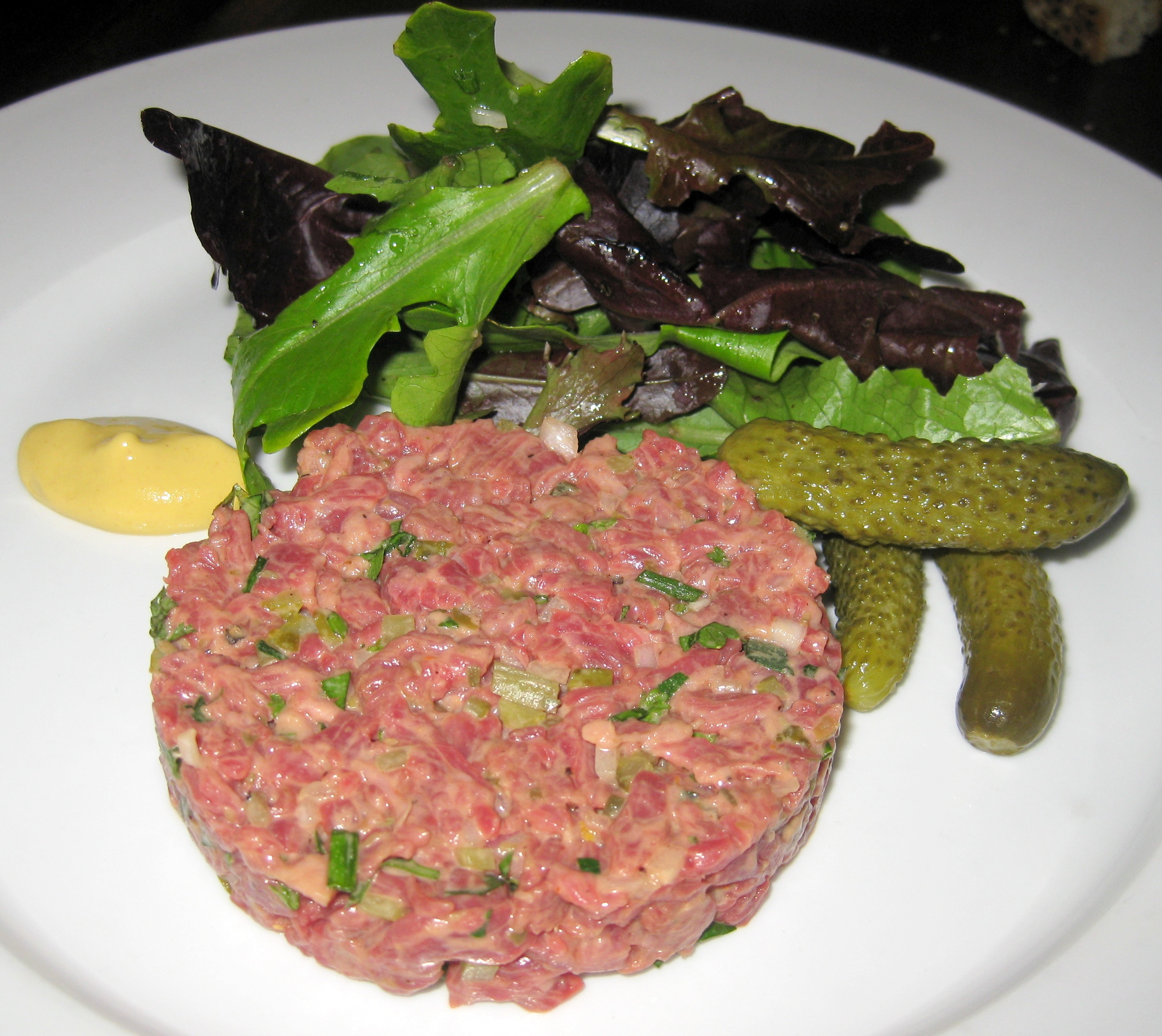 Steak tartare: handcut hanger steak with mesclun salad | GAYOT's Blog