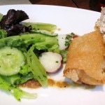 Applewood-smoked sturgeon blintz with potato and cucumber salad and grilled onion vinaigrette