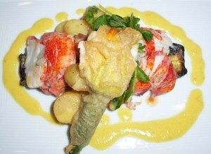 Maine lobster bake with fried baby zucchini blossoms and grilled zucchini