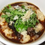 Braised beef cheek with risotto arborio, red wine sauce, arugula and parmesan cheese