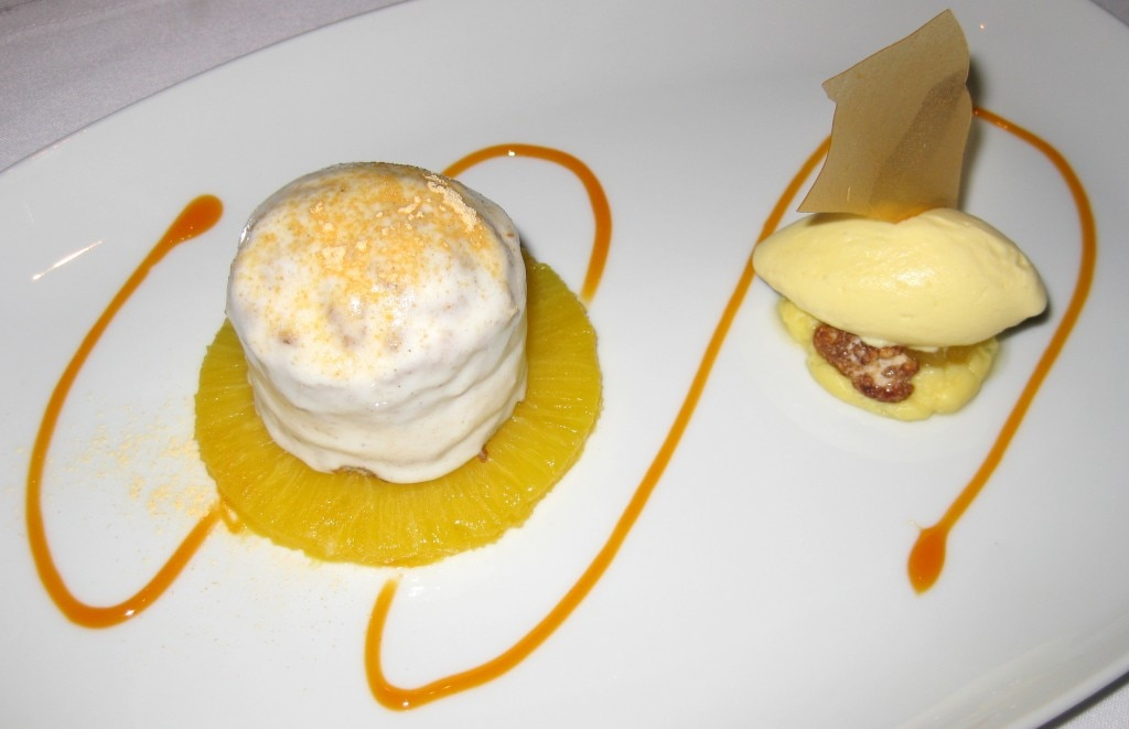 Spiced carrot cake with passion fruit cream, candied walnuts and coconut cream cheese ice cream