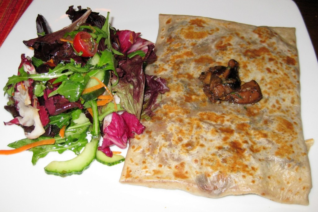 Sautéed cèpes mushroom crêpes with garlic and parsley